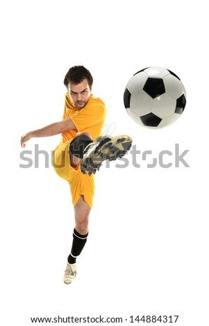Soccer player kicking the ball isolated on a white background