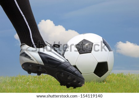 Soccer Player Kicking the ball - low angle  - stock photo