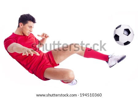 Soccer player making an acrobatic kick, isolated on white background - stock photo