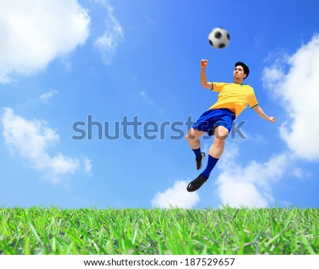 Soccer player man kick the ball at the stadium with blue sky