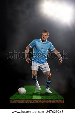 Soccer player playing in stadium  - stock photo