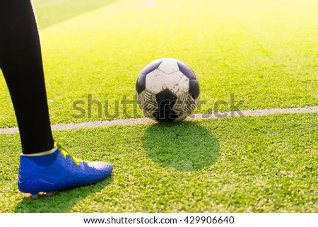 Soccer player ready to play at kick off the game in soccer field, background sunset, kick off, soccer game - stock photo