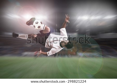 soccer player shoot over head kick on stadium light