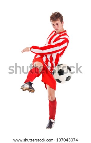Soccer player shooting a ball isolated on white background - stock photo