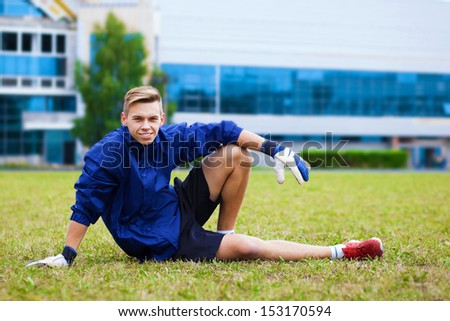 soccer player warming up before a game - stock photo