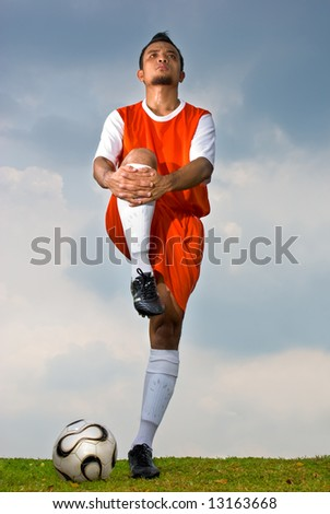 Soccer player warming up before the game start - stock photo