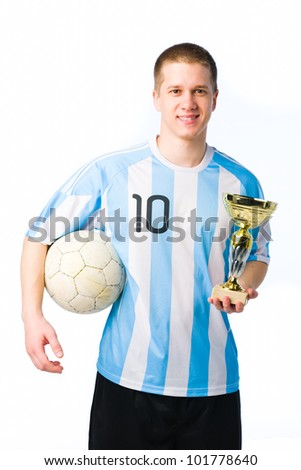 Soccer player with a ball and cup, white background. - stock photo