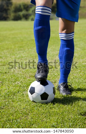 Soccer player with ball - stock photo