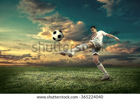 Soccer player with ball in action outdoors. - stock photo