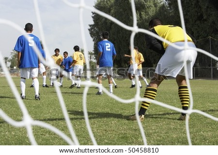 Soccer Players Competing for the Ball - stock photo