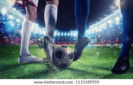 Soccer players with soccerball at the stadium during the match