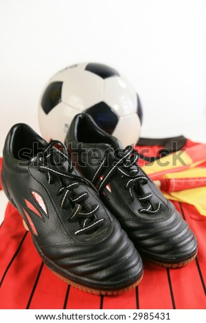 Soccer referee shoes shirt flags and ball - stock photo