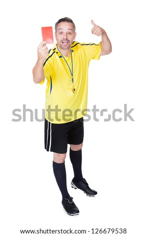Soccer Referee Showing Red Card On White Background - stock photo