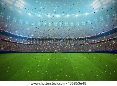 Soccer stadium in the night with fans in a match. All graphics are made up - stock photo