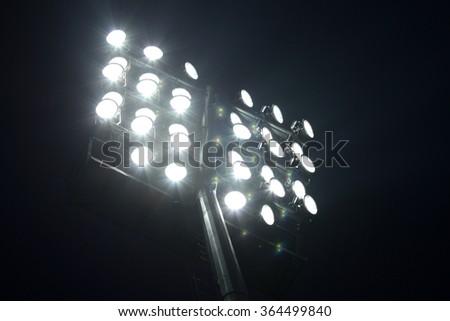 Soccer Stadium Lights over Dark Night Sky Background - stock photo