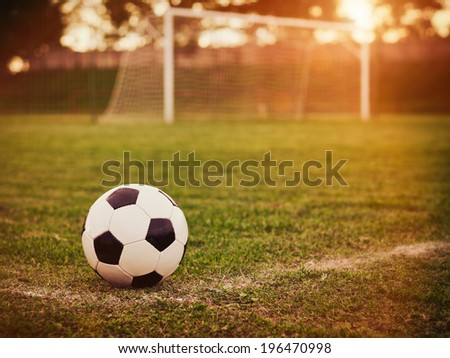 Soccer sunset / Football in the sunset - stock photo