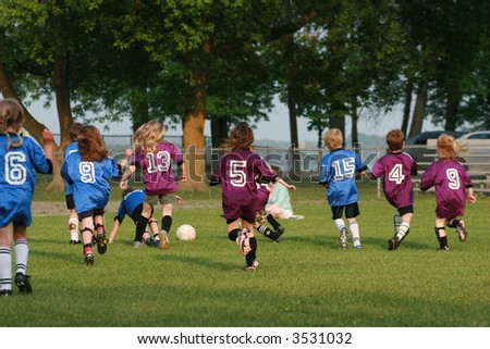 Soccer teams playing in the summer.