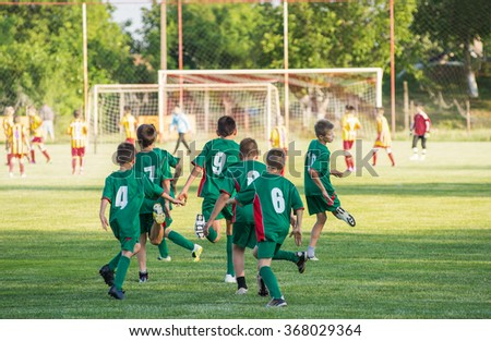 Soccer training for kids in football field - stock photo