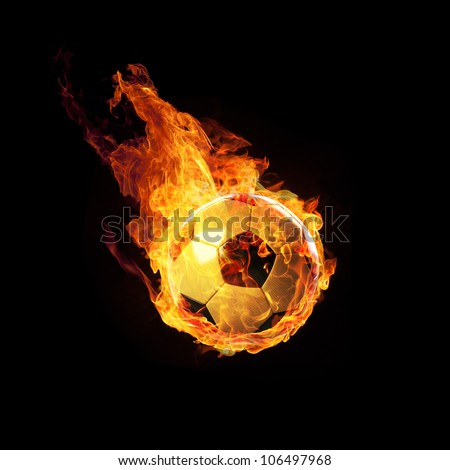 Soccerball on Fire or burning Soccerball on black - stock photo