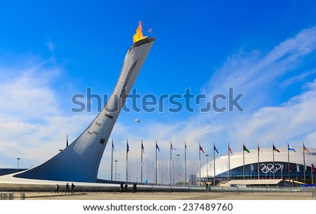 Sochi, Adler, Russia - February 14, 2014: the burning fire of Olympic games at the Olympic Park during the winter Olympic Games 2014 - stock photo