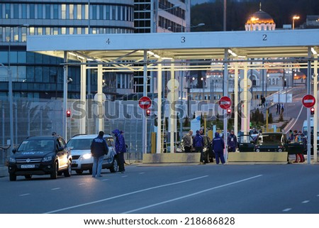 SOCHI, ADLER, RUSSIA - MAR 16, 2014: Increased security measures at the Olympic Park ahead of the closing of the Paralympic winter games in 2014. Inspection of vehicles and passengers