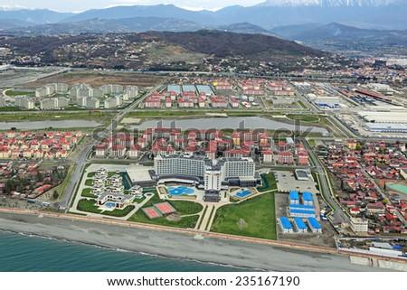 SOCHI, ADLER, RUSSIA - MAR 02, 2014: Modern hotel complexes on Olympic Prospekt near Olympic Park in Adlersky District, Krasnodar Krai, top view - stock photo