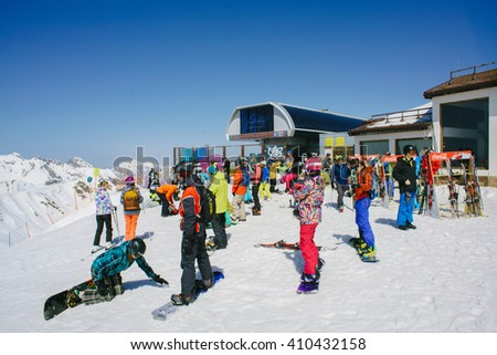 SOCHI, RUSSIA-APRIL 2016: snowboarders and skiers on ski slope - stock photo