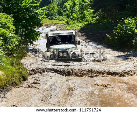 "SOCHI, RUSSIA - AUGUST 18: Off-road vehicle UAZ of team  during annual Natural selection in the ""MOUNTAIN OFF-ROAD SHOW 2012""on August 18, 2012 in Sochi, Russia - stock photo"