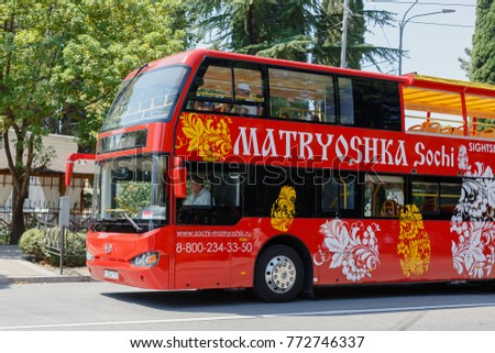 SOCHI, RUSSIA, AUGUST 18, 2017: tourists visiting the sights of the city of Sochi, on the red tourist bus matryoshka