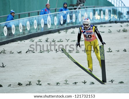 SOCHI, RUSSIA - DECEMBER 9: FIS Ski Jumping World Cup in Sochi on December, 9, 2012. Landing Olympic champion in ski jumping from the springboard Simon Amman