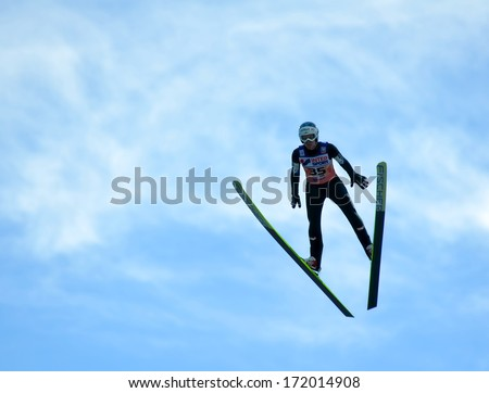 "SOCHI, RUSSIA - DECEMBER 9, 2012: FIS Ski Jumping World Cup in Sochi on tramplin complex ""RusSki Gorki"". Unidentified athlete in flight."