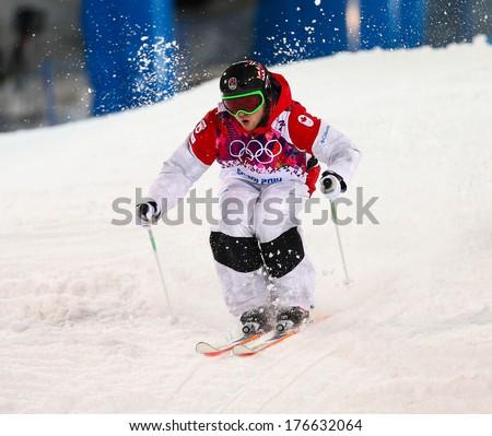 SOCHI, RUSSIA - FEB 10, 2014: Alex BILODEAU (CAN) at Men's Moguls Final of Freestyle skiing at Sochi 2014 XXII Olympic Winter Games - stock photo