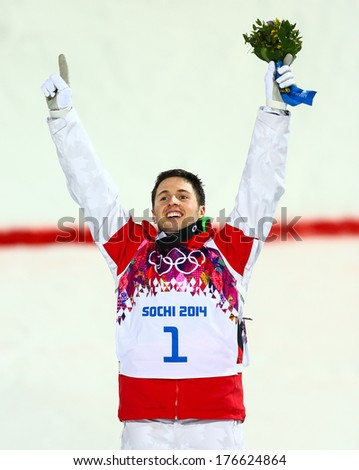 SOCHI, RUSSIA - FEB 10, 2014: Alex BILODEAU (CAN) at Men's Moguls flower ceremony of Freestyle skiing at Sochi 2014 XXII Olympic Winter Games - stock photo