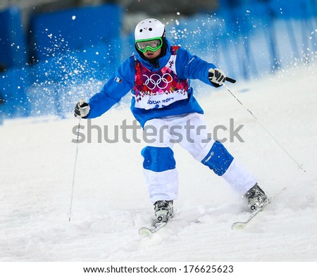 SOCHI, RUSSIA - FEB 10, 2014: Benjamin CAVET (FRA) at Men's Moguls Final of Freestyle skiing at Sochi 2014 XXII Olympic Winter Games