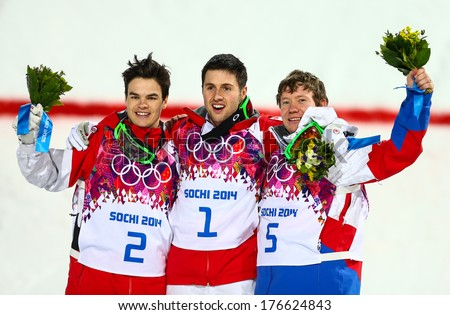 SOCHI, RUSSIA - FEB 10, 2014: KINGSBURY (CAN), BILODEAU (CAN), SMYSHLYAEV (RUS) at Men's Moguls flower ceremony of Freestyle skiing at Sochi 2014 XXII Olympic Winter Games