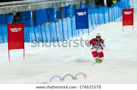 SOCHI, RUSSIA - FEB 10, 2014: Marc-Antoine GAGNON (CAN) at Men's Moguls Final of Freestyle skiing at Sochi 2014 XXII Olympic Winter Games - stock photo