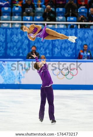Sochi, RUSSIA - February 11, 2014: Andrea DAVIDOVICH and Evgeni KRASNOPOLSKI (ISR) on ice during figure skating competition of pairs in short program at Sochi 2014 XXII Olympic Winter Games