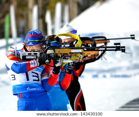 "SOCHI, RUSSIA - FEBRUARY 9: Andrey Turgenev and other athletes competes in IBU Regional Cup in Sochi on February 9, 2013. The combined ski-biathlon complex ""Laura"". Men's Pursuit firing line."