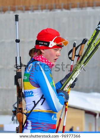 "SOCHI, RUSSIA - FEBRUARY 10: Cup of Russia on biathlon in Sochi on February 10, 2012. The combined ski-biathlon complex ""Laura"" for the Olympic Games 2014. Anna Suraeva after finish"