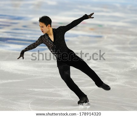 Sochi, RUSSIA - February 13, 2014: Denis TEN (KAZ) on ice during figure skating competition of men in short program at Sochi 2014 XXII Olympic Winter Games - stock photo