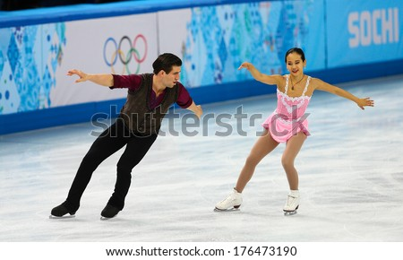 Sochi, RUSSIA - February 11, 2014: Felicia ZHANG and Nathan BARTHOLOMAY (USA) on ice during figure skating competition of pairs in short program at Sochi 2014 XXII Olympic Winter Games - stock photo