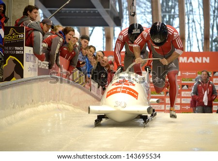 """SOCHI, RUSSIA - FEBRUARY 16: FIBT Viessmann Bobsleigh and Skeleton World Cup on February 16, 2013 in Sochi, Russia. Center Luge """"Sanki"""". Team Russia on track - stock photo"""