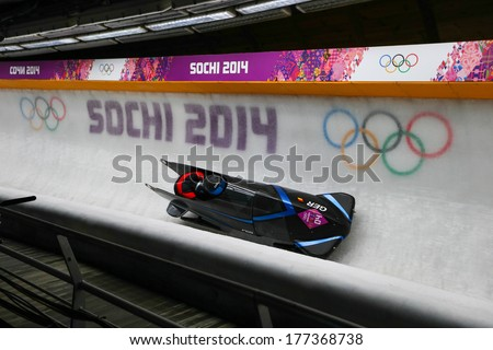 Sochi, RUSSIA - February 16, 2014: Germany 2 team at two-man bobsleigh heat at Sochi 2014 XXII Olympic Winter Games - stock photo