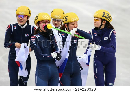 Sochi, RUSSIA - February 18, Korean team celebrates gold medal at Ladies' 3000 m Short Track Relay Final at the Sochi 2014 Olympic Games - stock photo