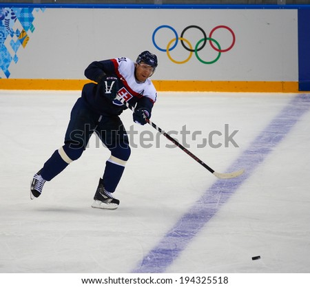 Sochi, RUSSIA - February 18, 2014: Marian HOSSA (SVK) on ice during Ice hockey Men's Play-offs Qualifications Game vs. Czech Republic team at the Sochi 2014 Olympic Games - stock photo