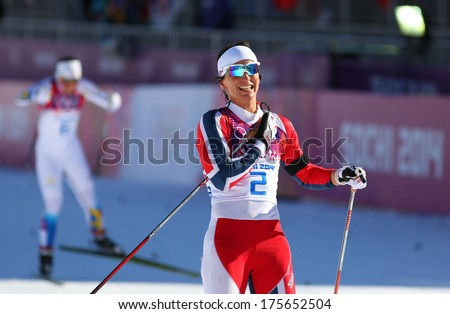 Sochi, RUSSIA - February 8, 2014: Marit BJOERGEN wins  in ladies' Skiathlon 7.5 km Classic + 7.5 km Free of Sochi 2014 XXII Olympic Winter Games - stock photo