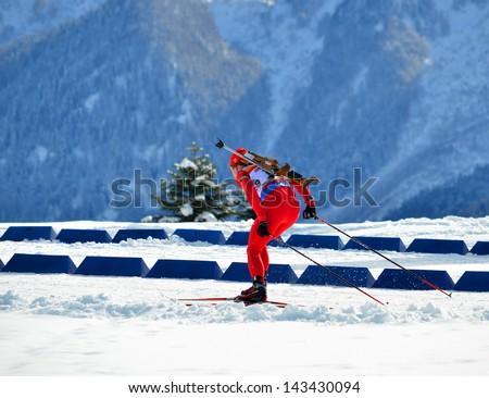 "SOCHI, RUSSIA - FEBRUARY 9: Marsel Sharipov competes in IBU Regional Cup in Sochi on February 9, 2013. The combined ski-biathlon complex ""Laura"". Male prosecution race. - stock photo"