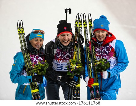 Sochi, RUSSIA - February 9, 2014: Medalists SEMERENKURO (L) KUZMINA (SVK) VILUKHINA (RUS) at Flower ceremony after Biathlon Women's 7.5 km Sprint at Sochi 2014 XXII Olympic Winter Games - stock photo