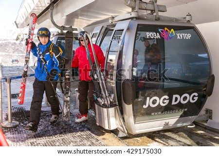 Sochi, Russia - February 10, 2016: Mountain lift in ski resort Rosa Khutor in Krasnaya Polyana - popular center of skiing and snowboard - stock photo