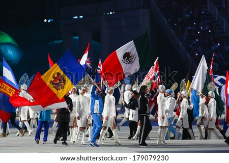 Sochi, RUSSIA - February 23, 2014: National flags at closing ceremony in Fisht Olympic Stadium at the Sochi 2014 Olympic Games - stock photo